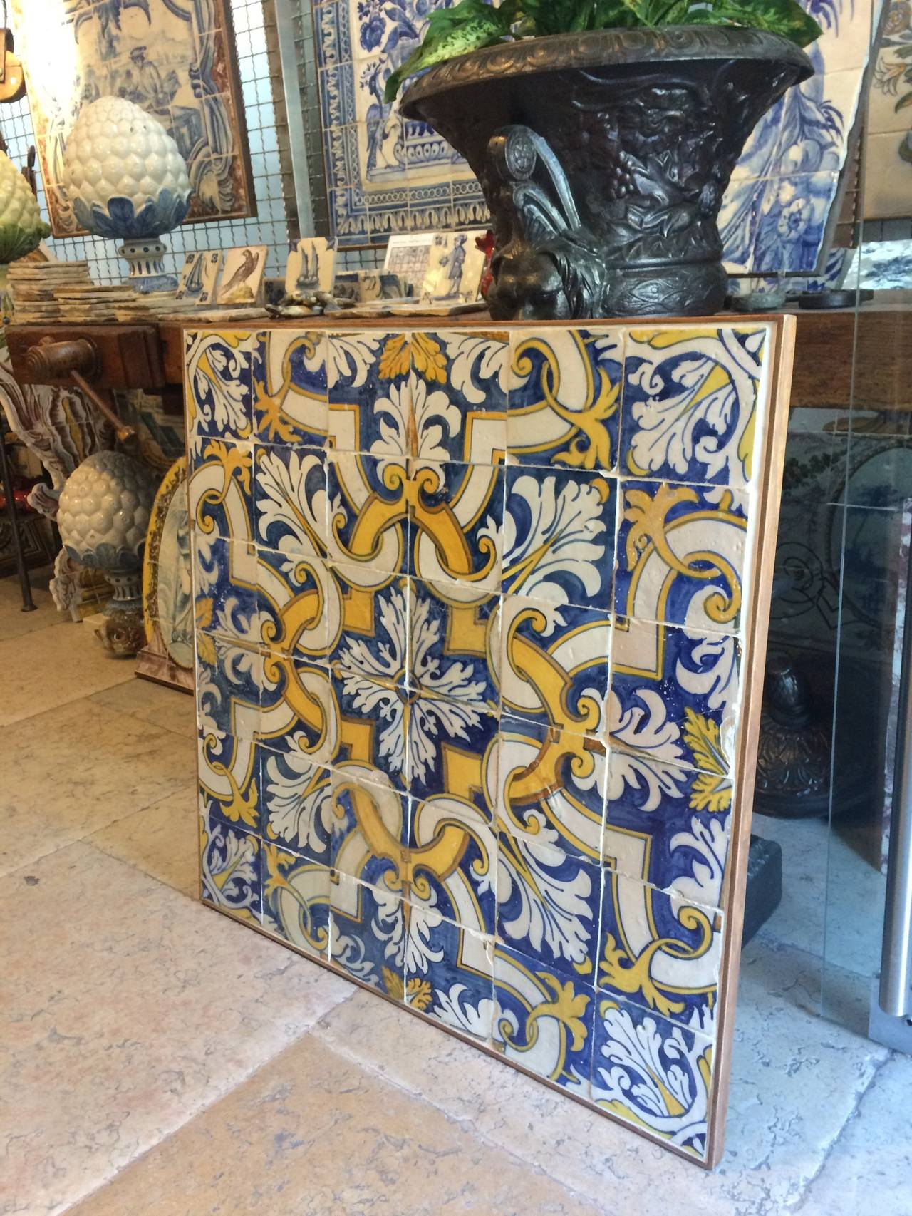 Azulejos polychrome mural composed by 36 tiles in a 6 by 6 module. Portugal set the taste for monumental ceramic tile applications in churches and palaces, covering entire walls and sometimes even ceilings. Before the 18th century golden age of