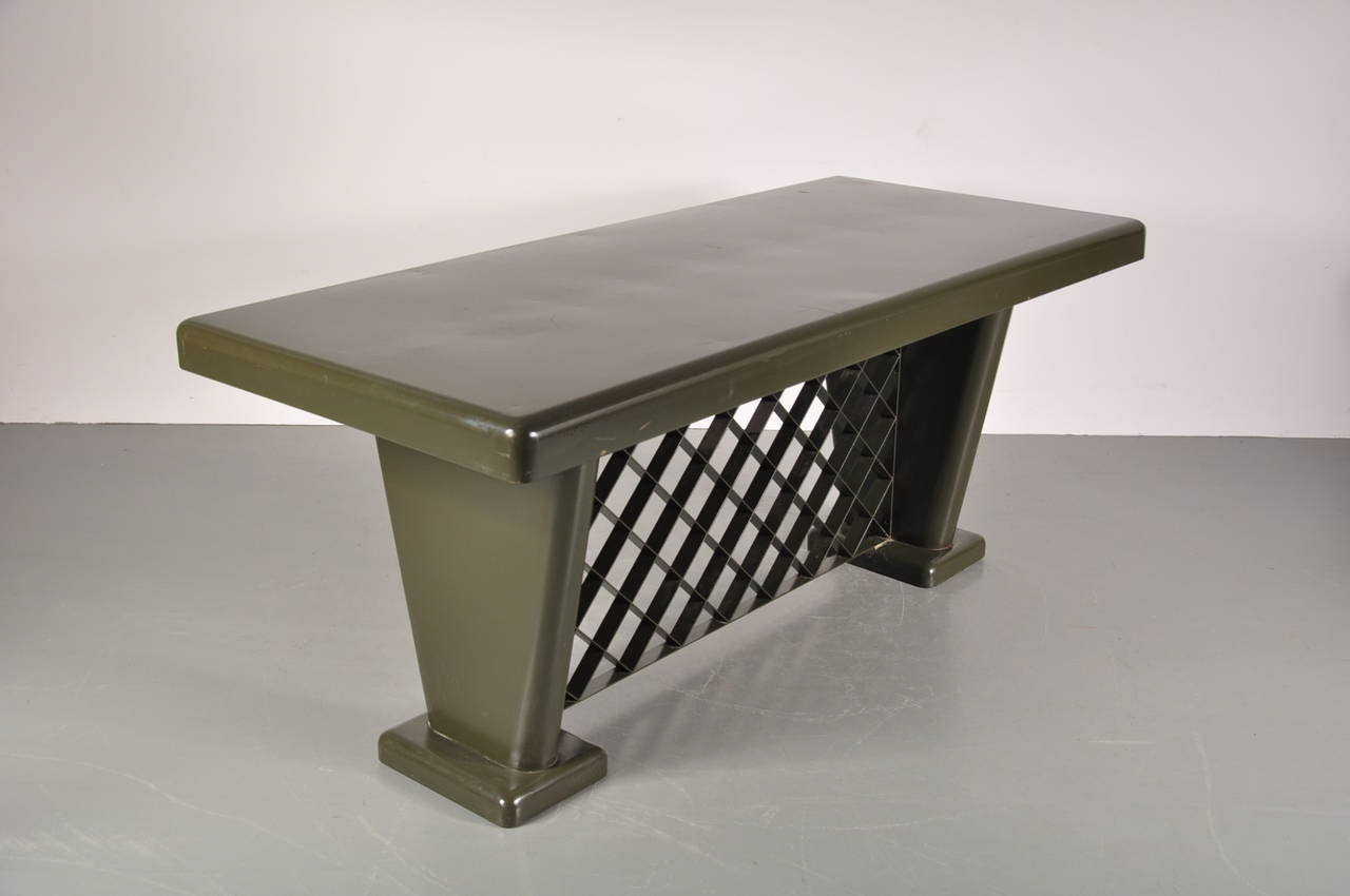 Unique German green metal Art Deco table manufactured, circa 1930.  This table has a beautiful industrial design and would fit perfectly in any modern interior.  In good original condition with minor wear consistent with age and use, preserving
