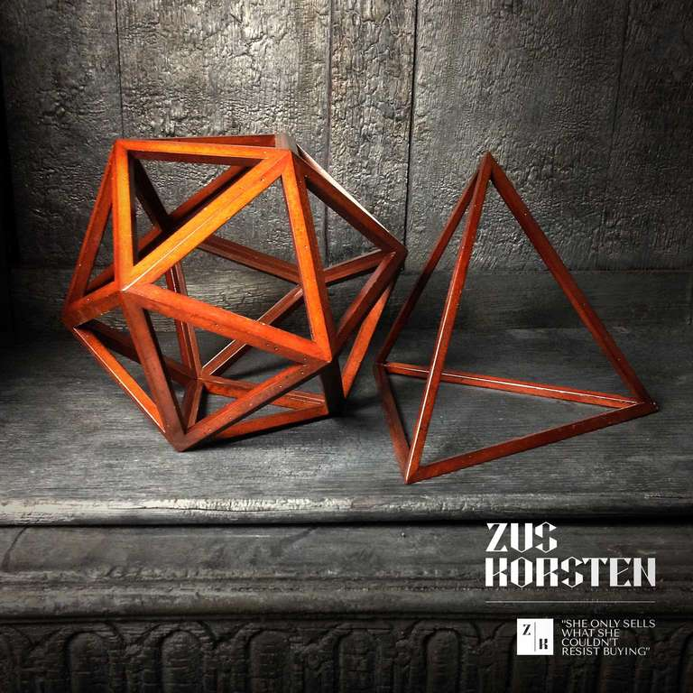 Two wooden spatial forms. A pyramid and a pentagon. Real craftsmanship.