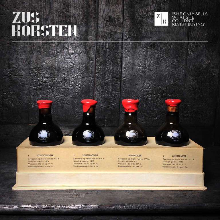 A cardboard display box with four 100ml Thermax double sided laboratory flasks made in Leerdam. The flasks are filled with oil samples taken from four different places in The Netherlands. Schoonbeek, IJsselmonde, Pijnacker and Zoetermeer. The flasks