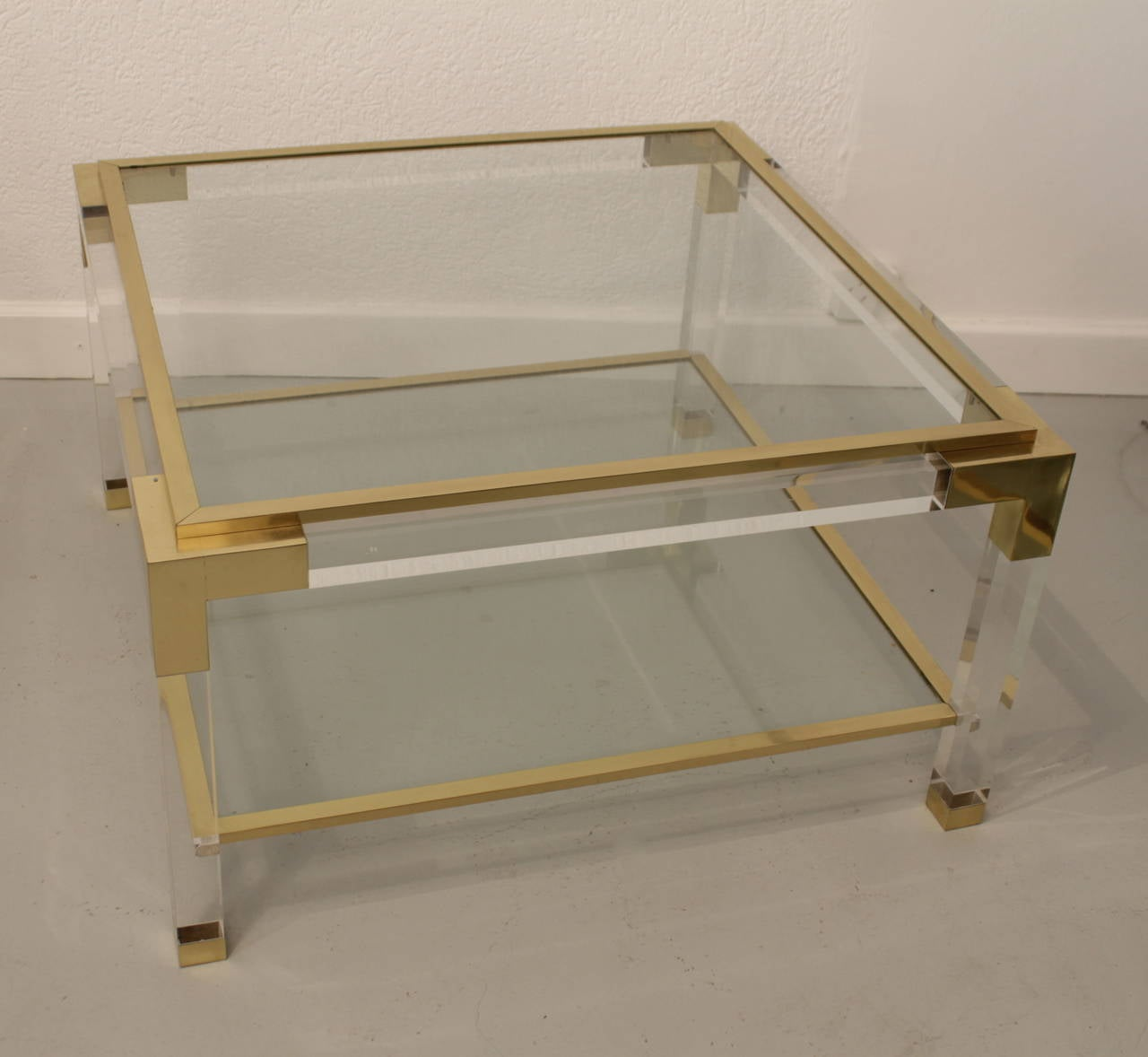 Lucite, brass and glass coffee table, Italy, circa 1970 The top glass is movable and edges are fitted with slip on brass trim. Very good quality.