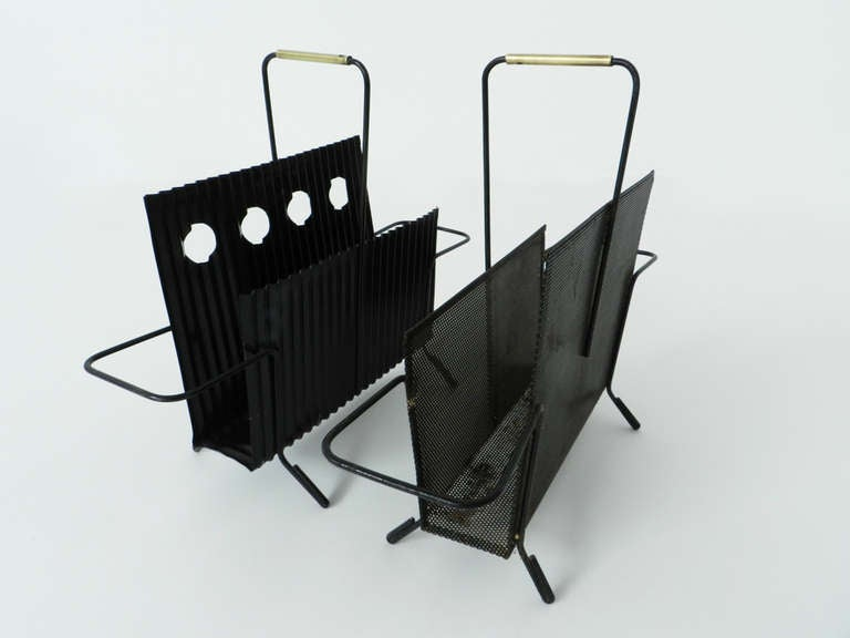 2 Java magazine holders by the the french master Mathieu Matégot. The tinplates are black painted with some brass details that give value to the minimal design.  Referenced in the Philippe Jousse book about Mathieu Mategot edited by Jousse.