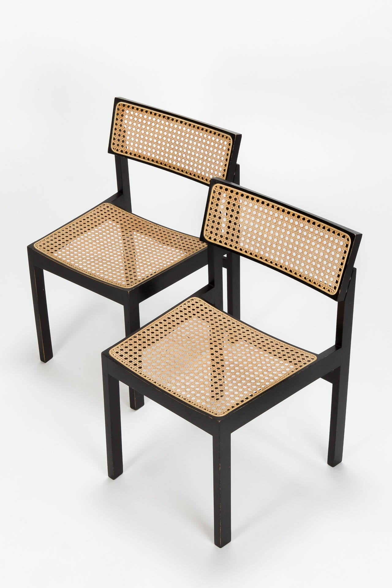 "A very classical pair of Swiss design chairs by Willy Guhl ""The Guhl Chair"" model 3100 for Dietiker, Switzerland in 1959. Stained beech-wood frame and hole to hole caning seat and backrest. Won the price ""die gute Form"" in 1960