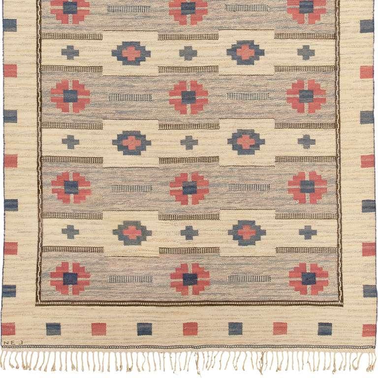 Flat-weave carpet, Sweden, mid-20th century. Initialed: NEJ.
