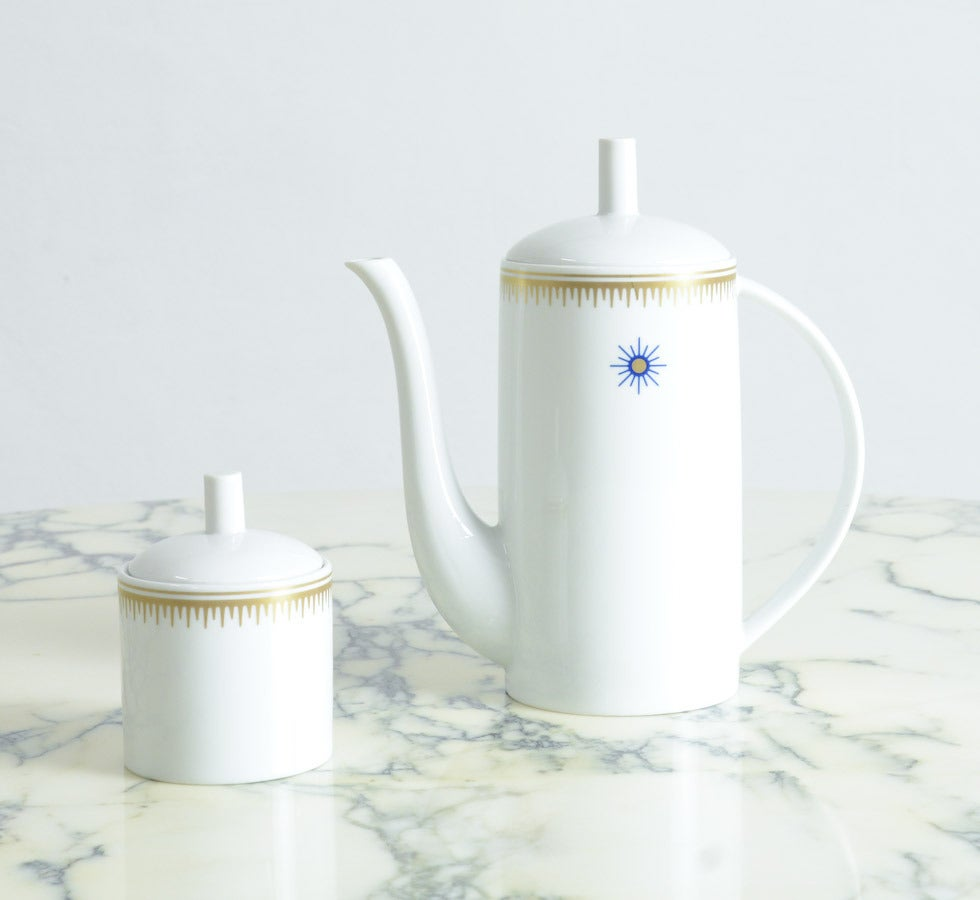 This Post-Modern coffee pot and sugar bowl is designed by Alessandro Mendini for Alessi, Tendentse in 1989.