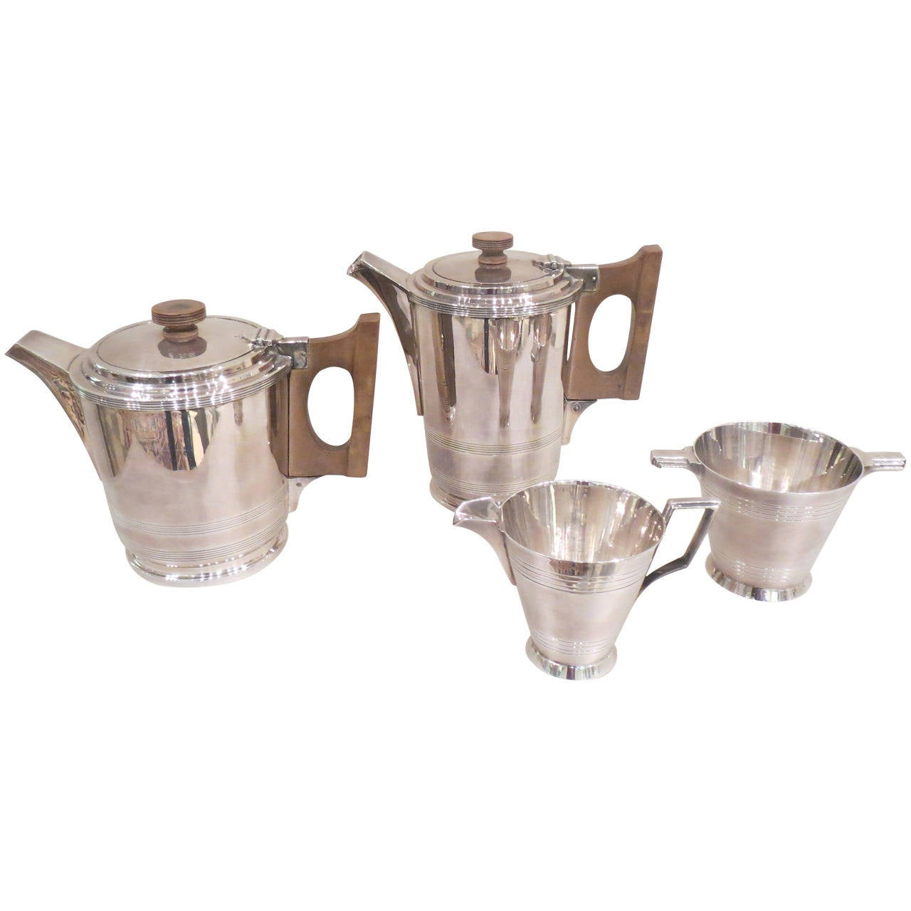 Four-Piece Art Deco Silver Plate Tea and Coffee Service by Walker & Hall For Sale