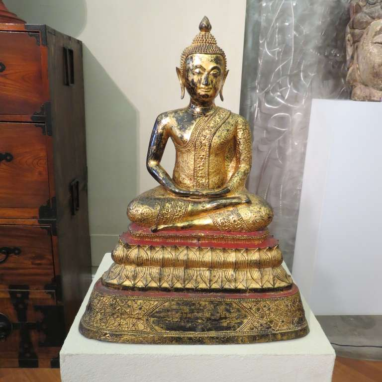 Antique late 19th century Thai Buddha bronze statue, with a lacquered and gilded surface, heavy and with beautiful details.