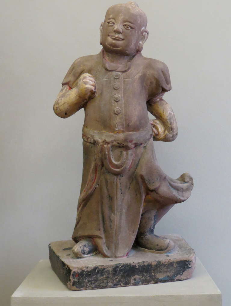 Large Chinese mid-19th century sand stone sculpture of a scholar.