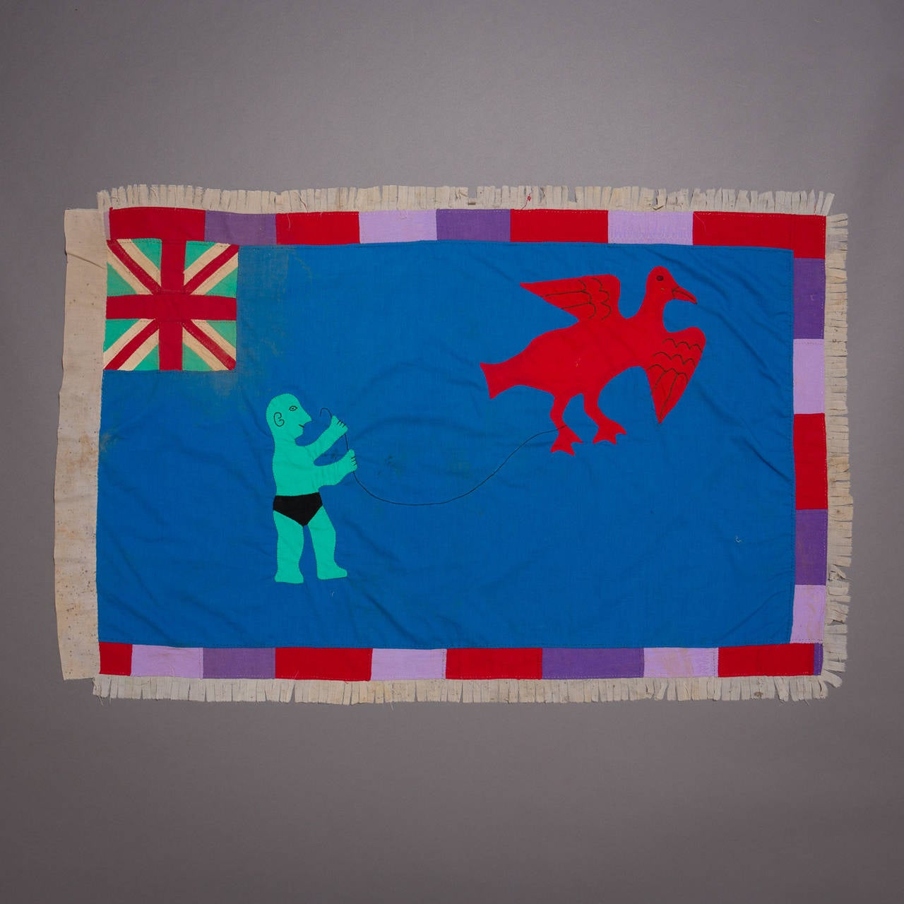 A large and graphically stunning Asafo flag.  Fante flags represent the merger of two cultural traditions, the Akan tradition of combining proverbs with visual imagery and the European heraldic tradition, which used flags and banners displaying