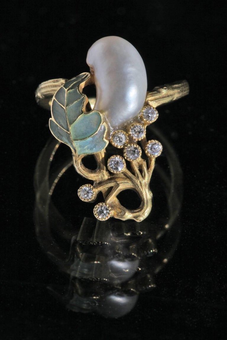 An exceptional Art Nouveau ring in the manner of Georges Fouquet. . The baroque-shaped natural pearl measuring approximately 11.3 x 7.6 mm. Ring Size: UK:L US:5.75 EU:51.2 Asia:11
