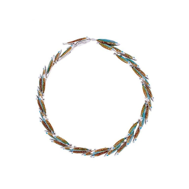 Wife of the ancient Greek Sea God Thaumas, Electra presided over the aquatic kingdom and marine life. A school of fish in hues of iridescent greens, move elegantly together as their flow through the water's current, creating lines of graphic