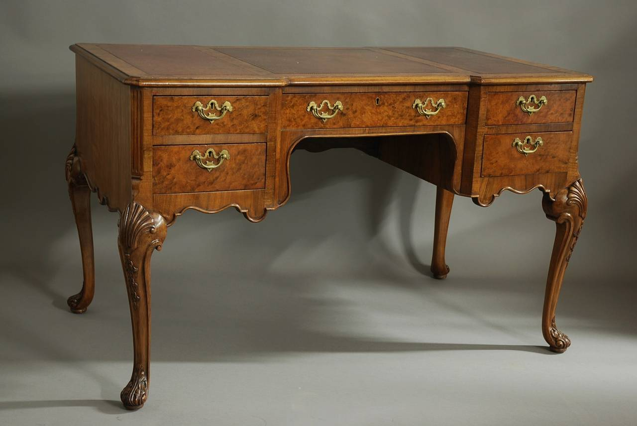 An early 20th century inverted breakfront walnut writing desk in the Queen  Ann style. The - Walnut Writing Desk In The Queen Ann Style For Sale At 1stdibs