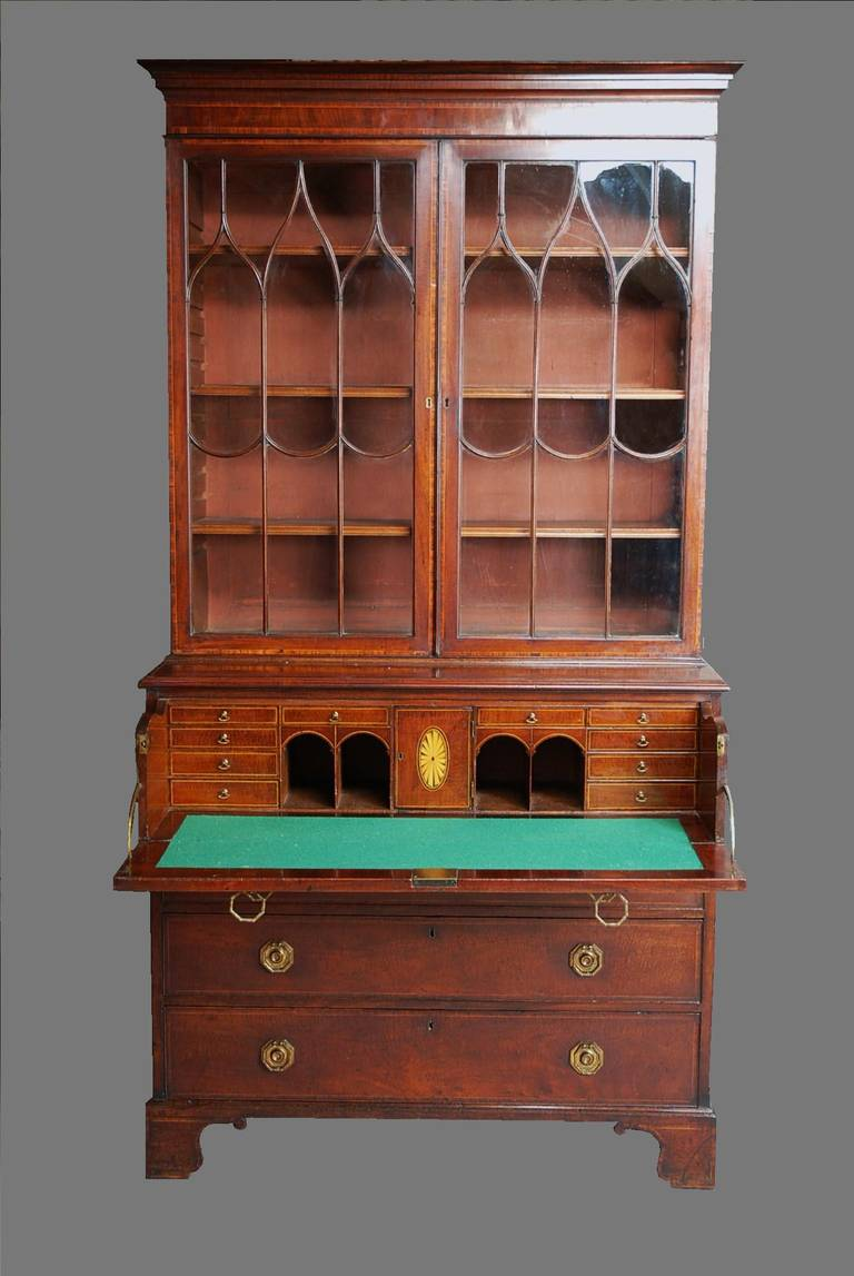 A late 18th-early 19th century mahogany secretaire bookcase of good patina (color).  This bookcase comprises of a moulded cornice to the top with an inlaid frieze consisting of fine quality mahogany, boxwood and Kingwood.  This leads down to two