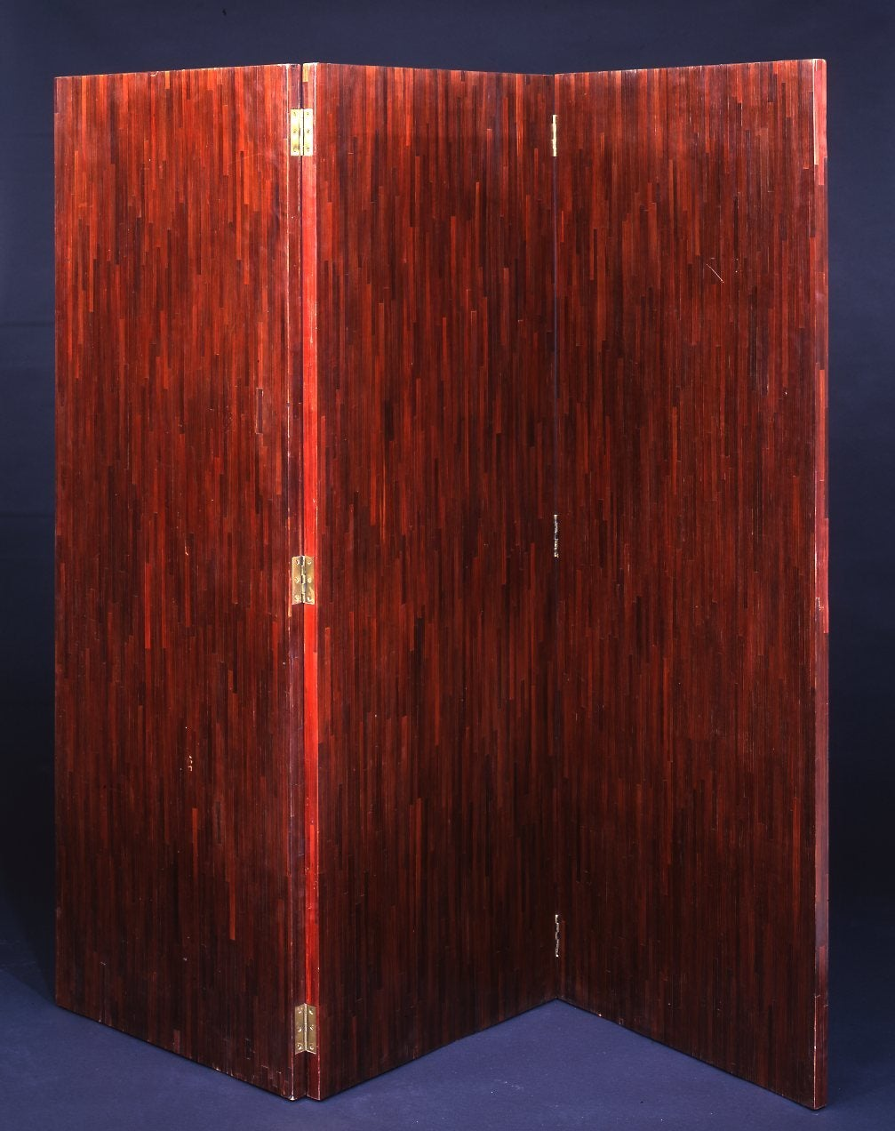 Straw marquetry screen opening on three panels. Darkened mahogany stained on both sides. Unsigned, circa 1932  Literature :