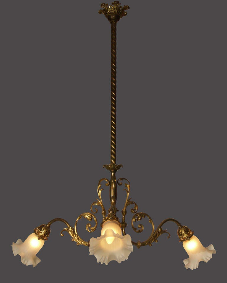 Around 1900 in Vienna the private houses were connected to the electricity grid. At that time the common gaslights were changed to the new technology. As well new chandelier were built for electric light only. This typical Viennese chandelier has
