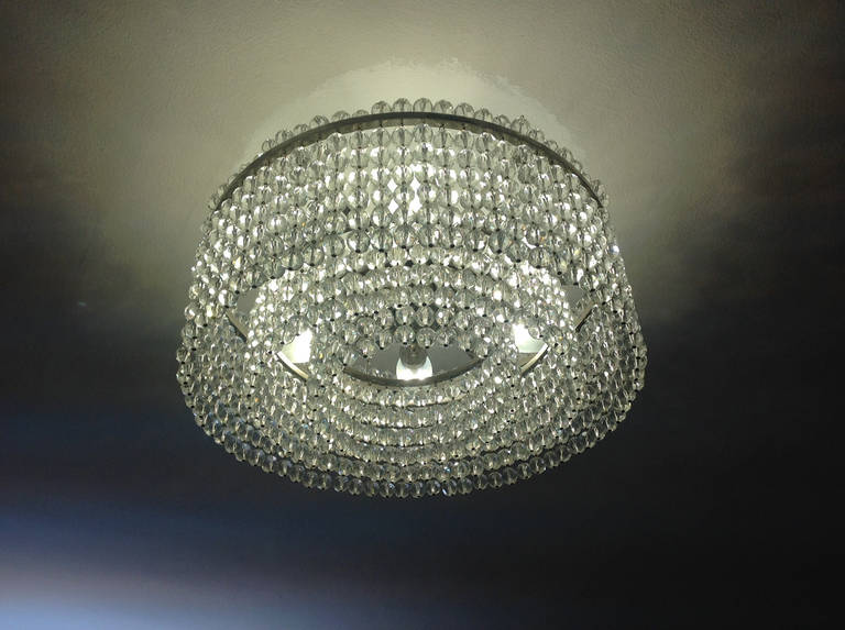 A very modern and stylish chandelier with hand-cut crystal balls in three layers and six bulbs, with the name