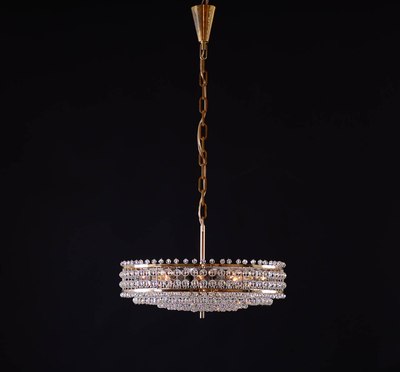 A very charming Bakalowits chandelier from the 1960s, 12 flames, the height is just the chandelier. Materials & Techniques Notes: brass and hand-cut crystal-glass