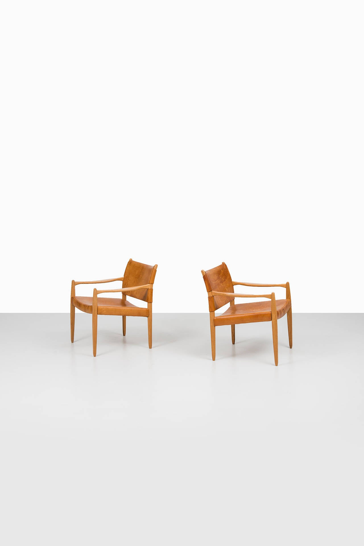 A pair of easy chairs model Premiär designed by Per-Olof Scotte. Produced in Sweden.
