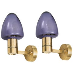 Hans-Agne Jakobsson Wall Lamps in Brass and Purple Glass