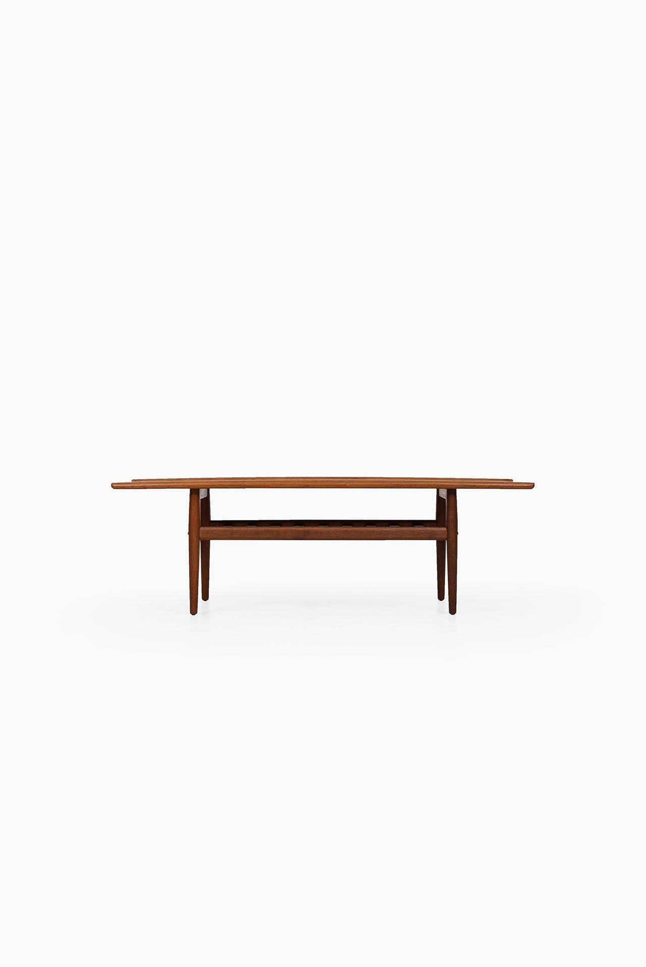 Coffee table in solid teak designed by Grete Jalk. Produced by Glostrup møbelfabrik in Denmark.