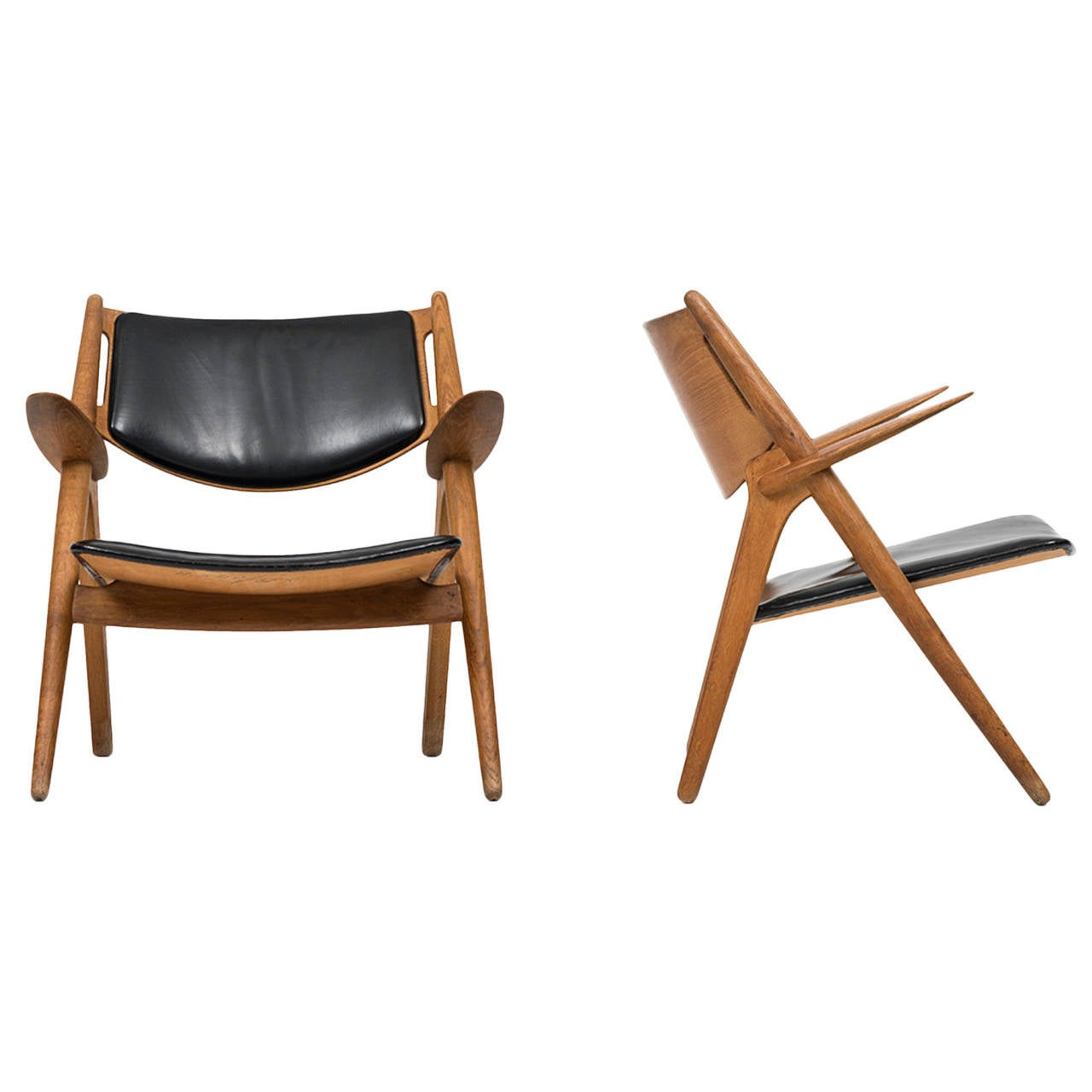 this hans wegner ch 28 easy chairs in oak and black leather is no