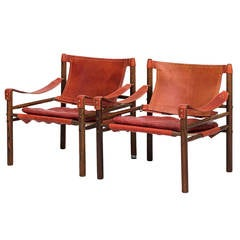 Arne Norell Sirocco Easy Chairs in Rosewood and Brown and Red Leather