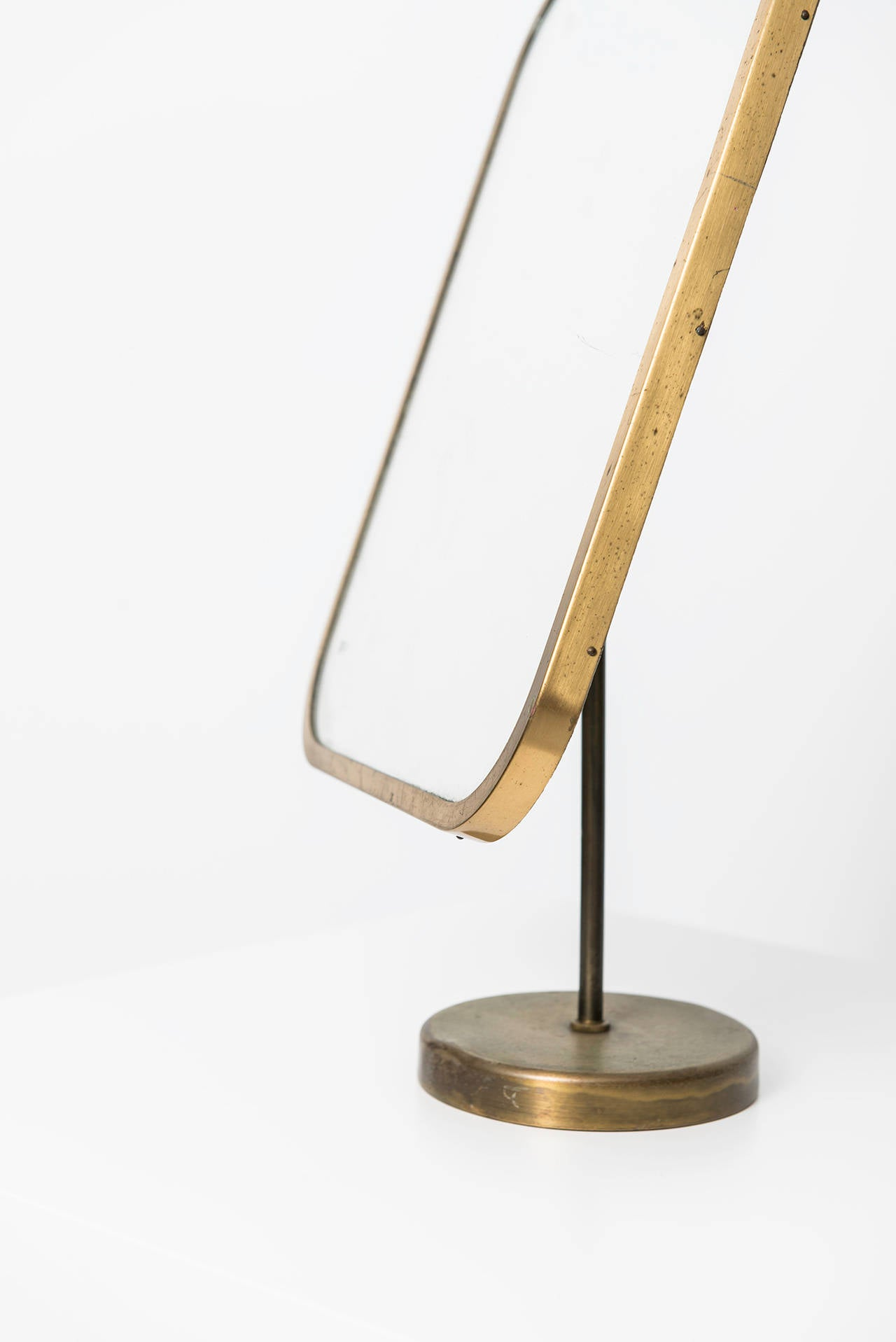 Rare table mirror in brass designed by Josef Frank. Produced by Nordiska Kompaniet in Sweden.