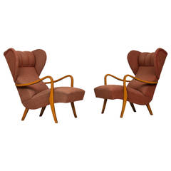 Pair of 1940's wingback lounge chairs produced in Sweden
