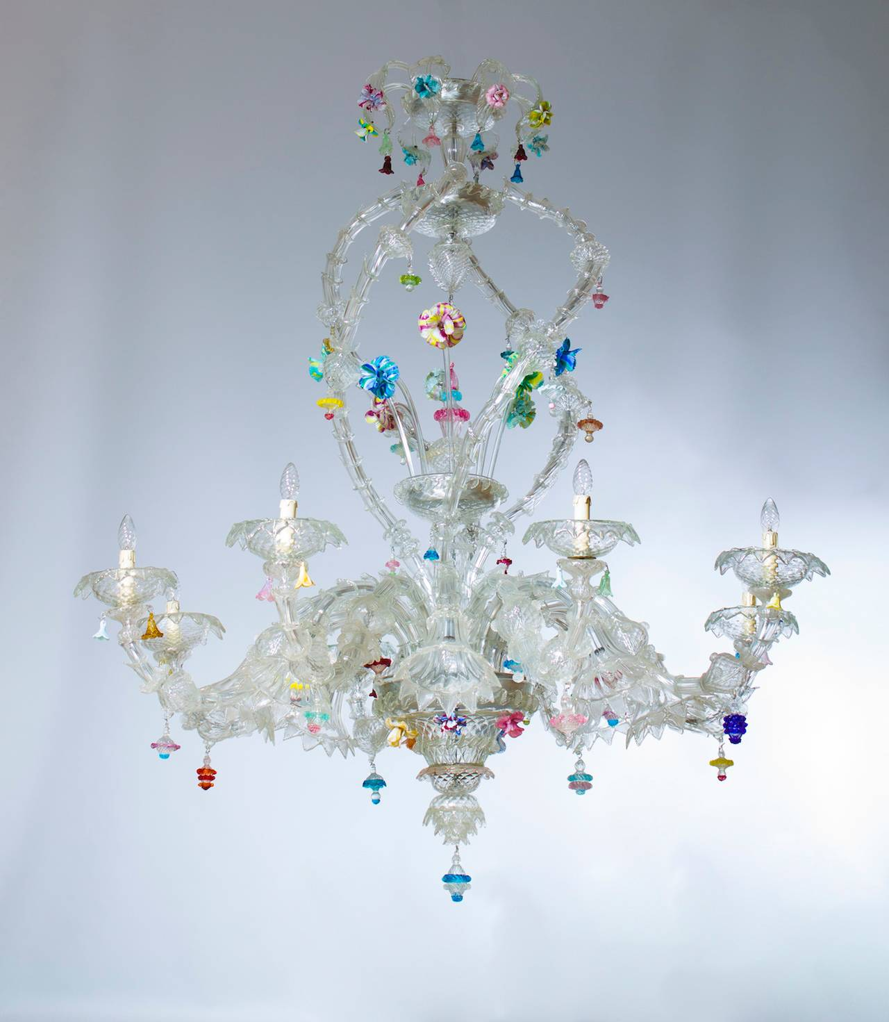 Italian Venetian Ca'rezzonico chandelier, blown Murano glass, Seguso, 1950s. Fantastic Italian Murano Ca'rezzonico chandelier, attributed to Seguso, in transparent color and multicolored finishes, composed by six low arms and six high arms, and by