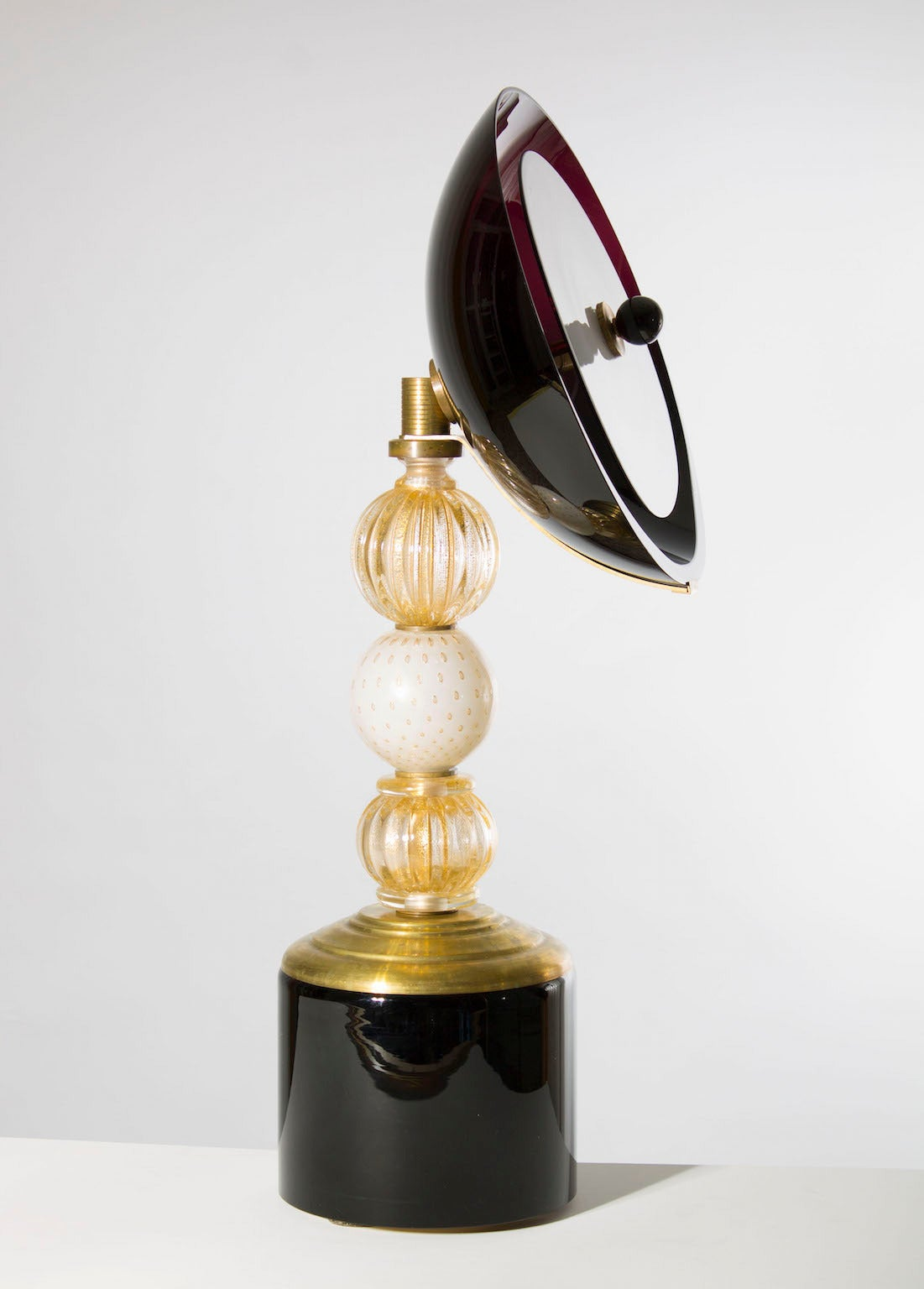 Amazing, modern, Italian Venetian, pair of table lamps, blown Murano glass, gold 24-karat black, in a very unique design, mixing a baroque style in the main body of the table lamps, with a modern parabolas at the very top. These table lamps, have a