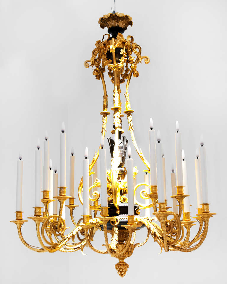 An important chandelier of Napoleon III period in the style of Louis XVI, with eight arms of light decorated with foliage holding twenty-eight lights on two levels. The central shaft is decorated with a neoclassical fire urn placed on a bouquet of