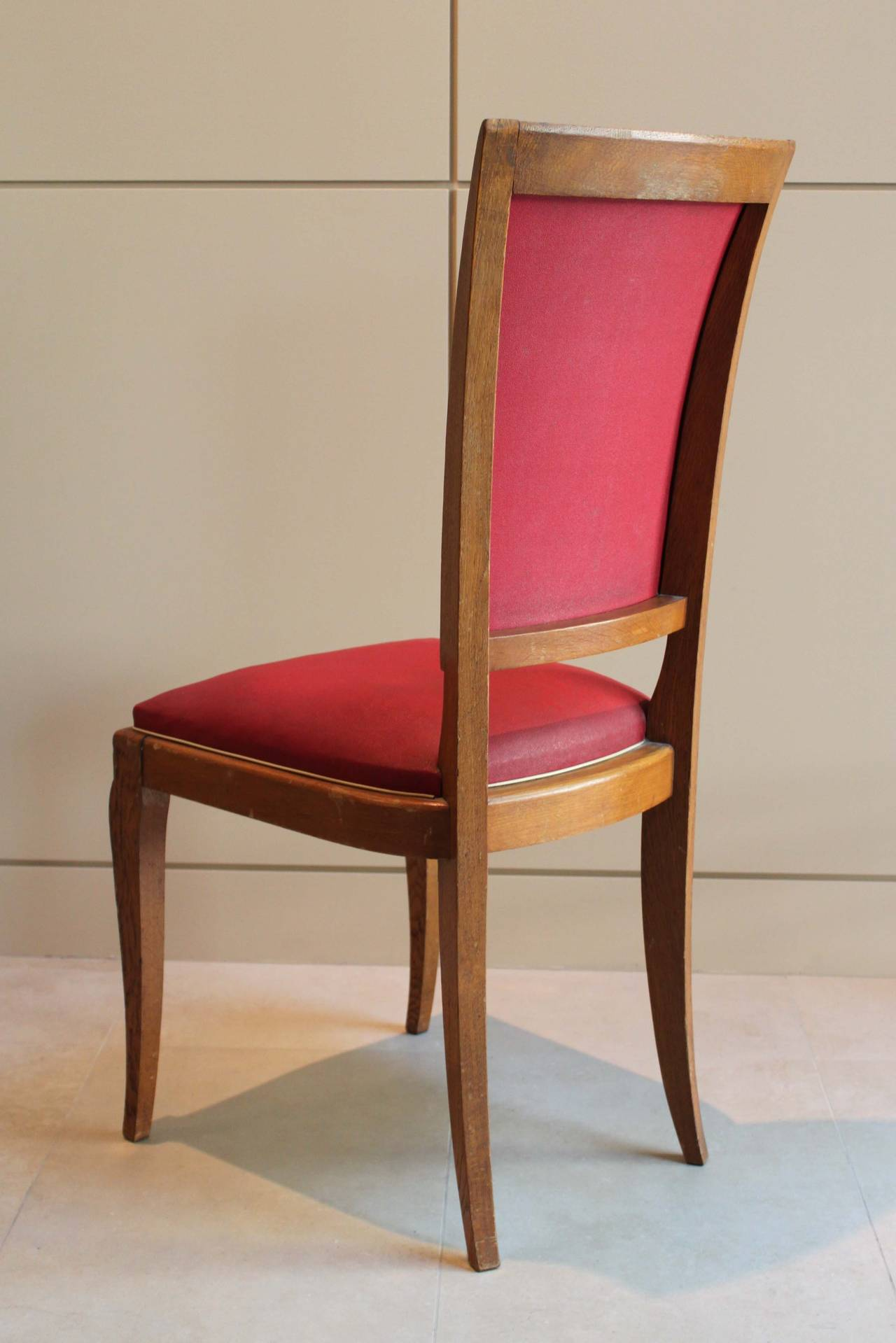 Set of six dining chairs in the Art Deco style, original condition. Solid construction, cabriolet and splayed legs. Vintage upholstery, unrestored.