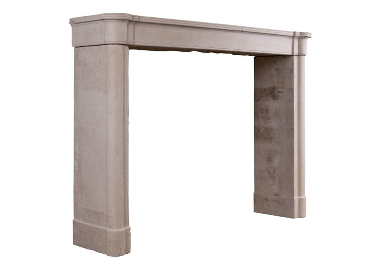 A small, well proportioned French stone Directoire fireplace. The jambs with half round columns surmounted by plain frieze and reeded shelf, circa 1800.  Shelf width: 1372 mm / 54 in Overall height: 1003 mm / 39 ½ in Opening height: 883 mm / 34 ¾