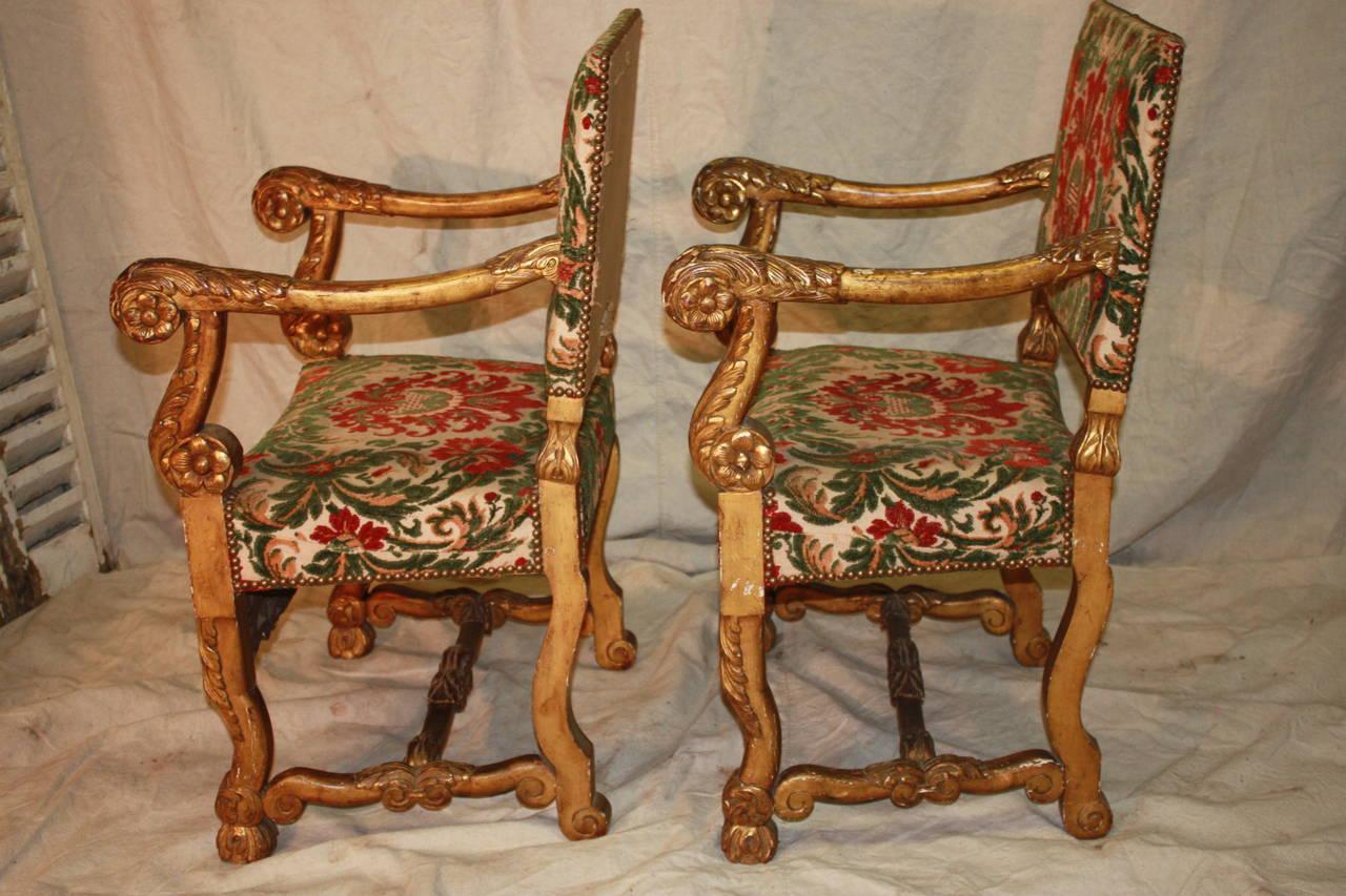 18th century Italian giltwood armchairs.