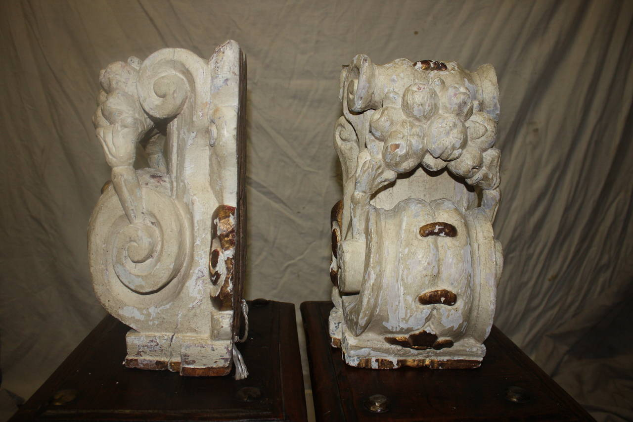 Pair of 18th century painted carved wall consoles, Louis XIV style, French.
