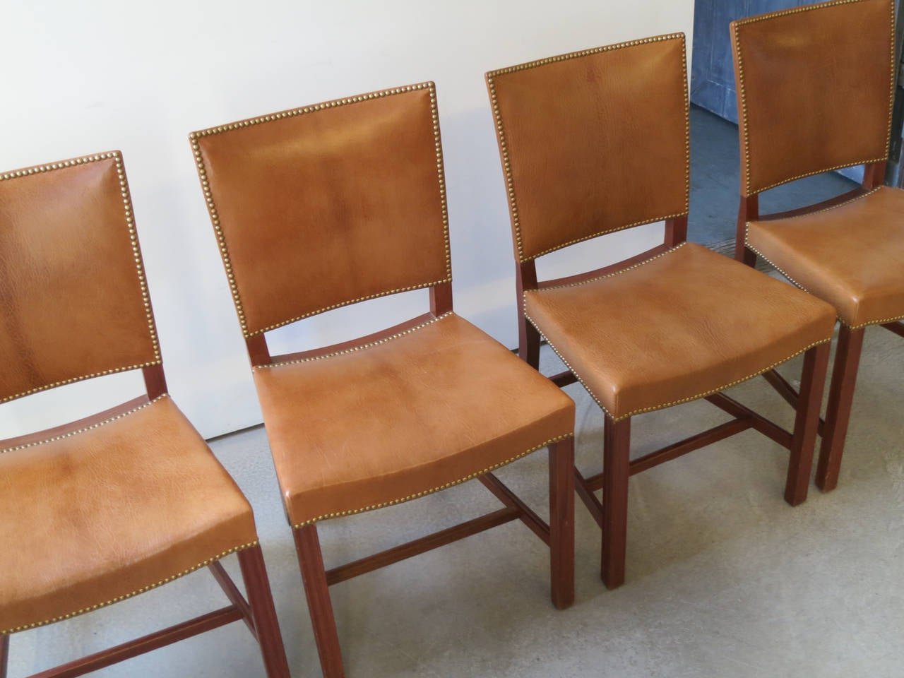 "Early set of teak and nigerian goatskin ""red chairs by"