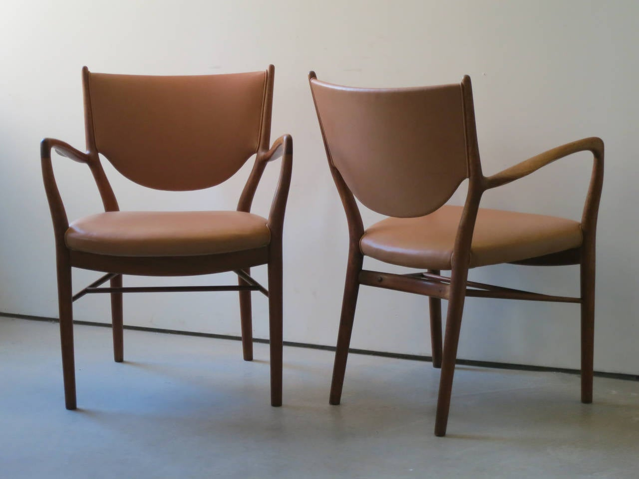 Danish Pair of NV46 Chairs by Finn Juhl in Teak with Natural Leather Upholstery For Sale