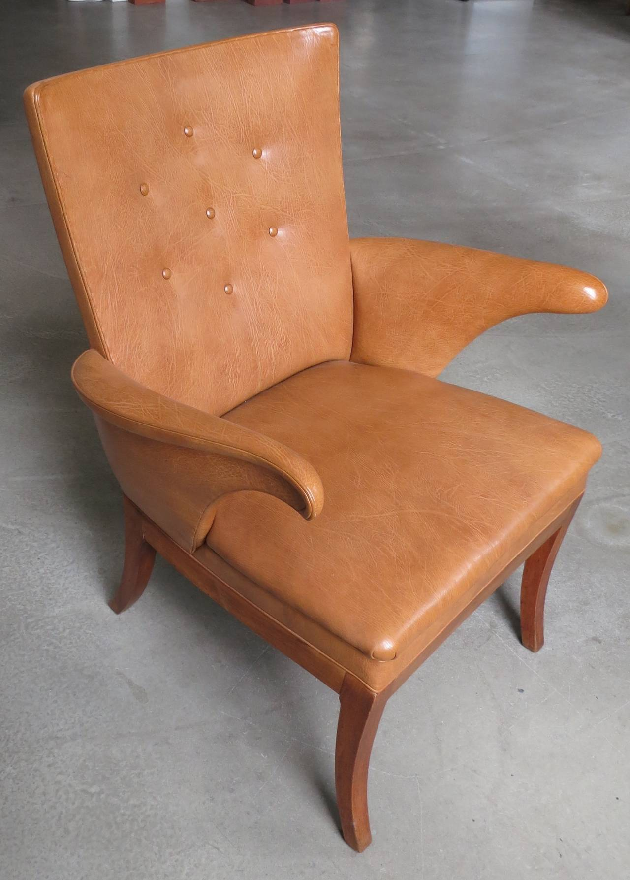 Armchair in Nigerian Goatskin by Frits Henningsen, 1930s. Designed and made by Frits Henningsen, this iconic chair is comfortable and elegant at the same time. It is upholstered in Nigerian goatskin with brass nailheads and sits on European walnut