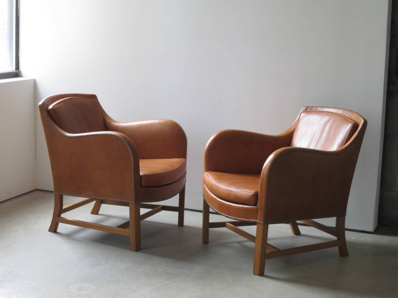 "Offered by Vance Trimble, Pair of ""Mix"" Chairs in Nigerian Goatskin with Brass Nailheads by Kaare Klint.  About the chair. Klint named the Mix chair on a sketch, where he described it as ""a mixture of Kindt and Klint"". In doing so he"