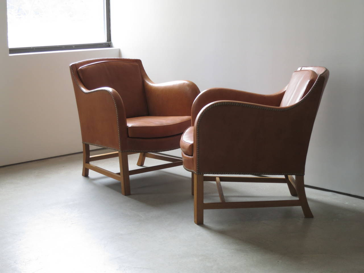 "Scandinavian Modern Pair of ""Mix"" Chairs in Nigerian Goatskin with Brass Nailheads by Kaare Klint For Sale"
