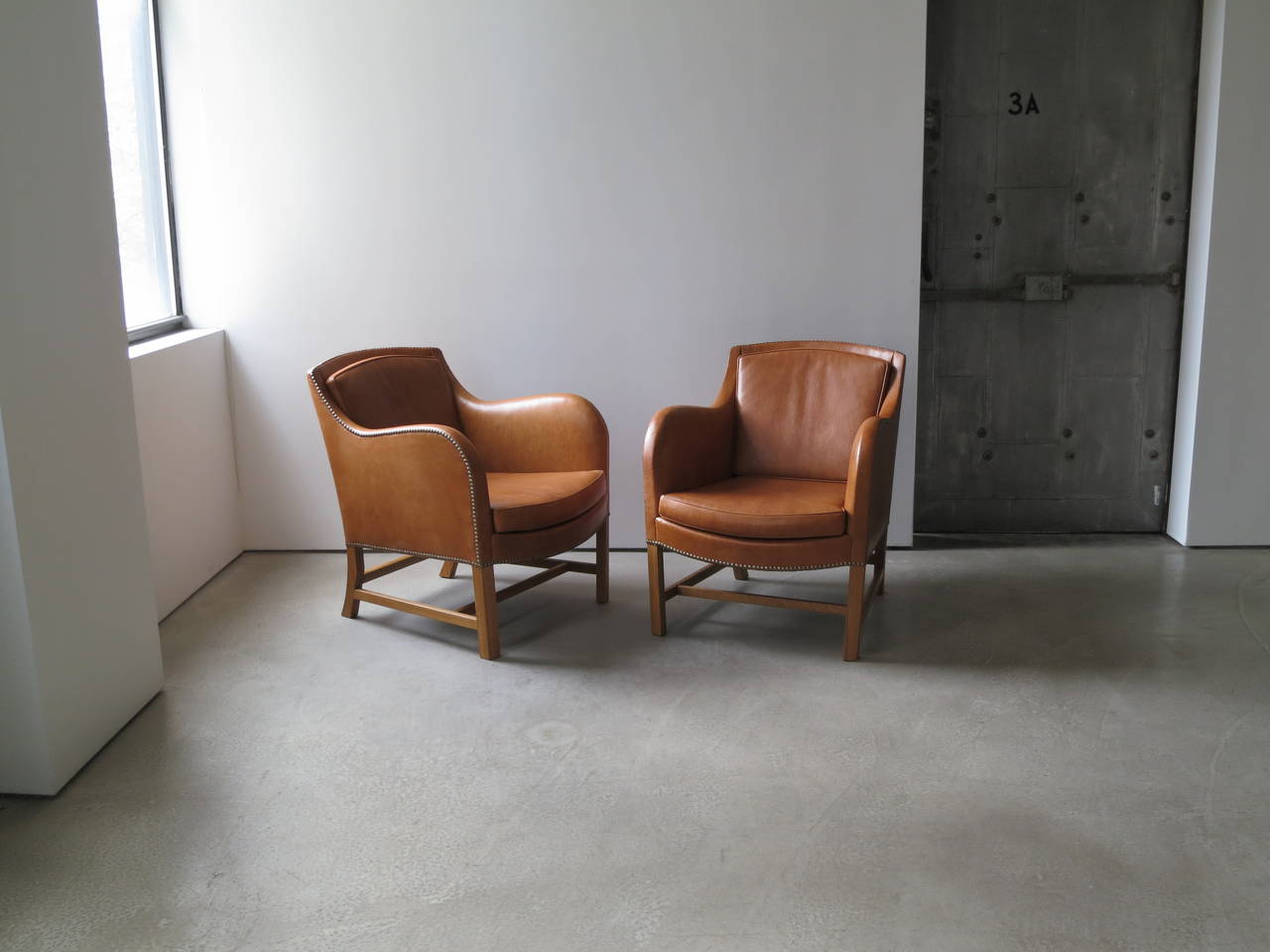 "Mid-20th Century Pair of ""Mix"" Chairs in Nigerian Goatskin with Brass Nailheads by Kaare Klint For Sale"