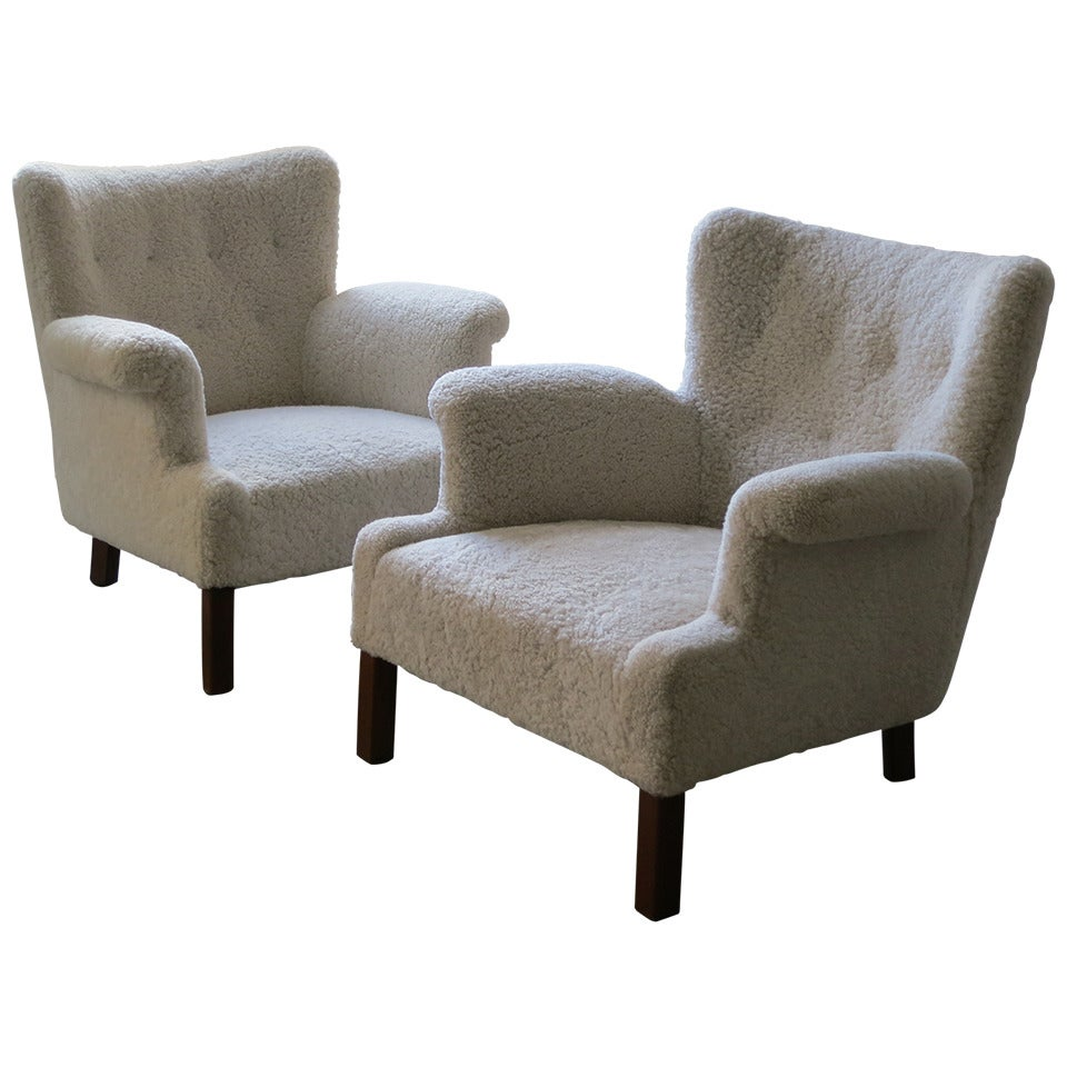 Pair of elegant and refined sheepskin lounge chairs by for Contemporary furniture chairs