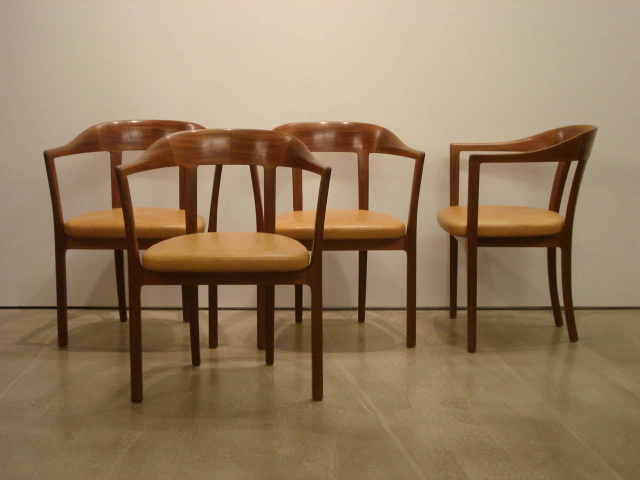 Ole Wanscher, Set of Four 1958 Armchairs in Mahogany and Original Leather Seats.   Made by master cabinetmaker A.J. Iversen, Copenhagen.  Designed in 1958; these chairs date to circa 1958. Mahogany with original natural leather upholstered