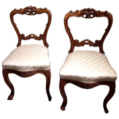 Pair of 19th Century Carved Satinwood Balloon Back Chairs