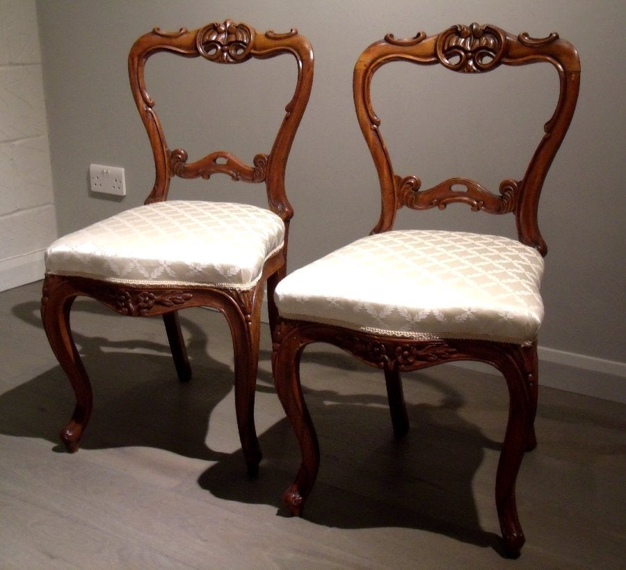 A very handsome pair of mid-19th century carved solid satinwood chairs with  upholstered seats - Pair Of 19th Century Carved Satinwood Balloon Back Chairs For Sale