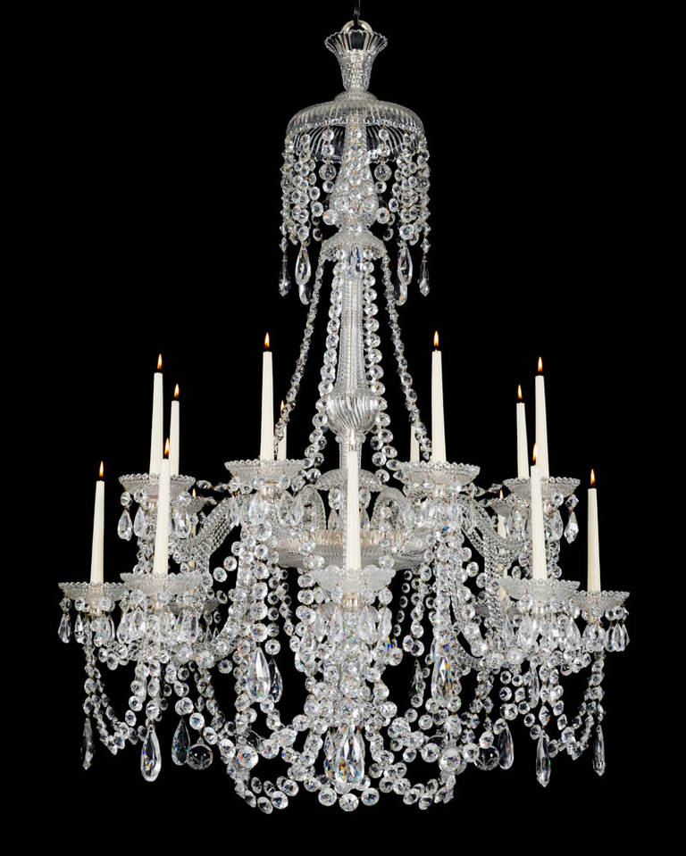 The two tiers of rope twist branches issuing from a mitre cut receiver bowl this with a drop hung under canopy and lapidary cut finial, the baluster shaped shaft with draping pan and swaged canopy the chandelier profusely draped with double pointed