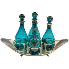 Fine Set of Green Georgian Decanters in a Silver Boat Shaped Stand