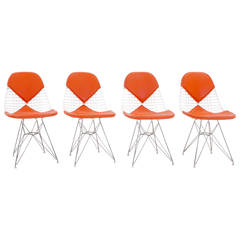 Four Eames Herman Miller DKR Wire Chairs on Eiffel Bases & Orange Girard Vinyl