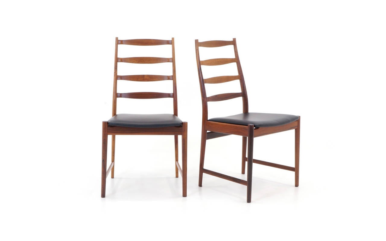 Twelve high back rosewood danish modern dining chairs by for Modern high back dining chairs