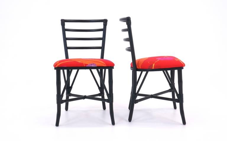 Set of four 1940's Rattan Chairs redone in black lacquer and reupholstered in a striking Unika Vaev fabric